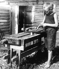 Boy doing woodwork at a pioneer camp, 1930s (Cicely Osmond Collection, SCRSS Photo Library)